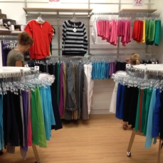 They had several fixed price racks at $10 (shirts), $14 (capris, to the left), and $15 (leggings, to the right).
