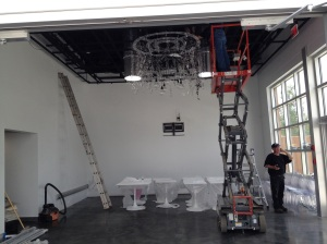 Getting the dining room space ready by installing the chandelier!